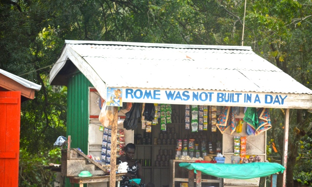 shack with bright colors and Rome Wasn't Built In A Day printed above the door.
